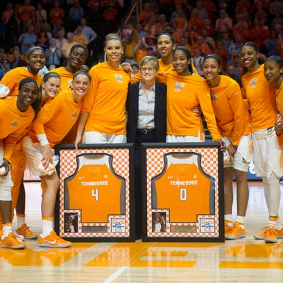 The Lady Vol basketball team poses for a photo with