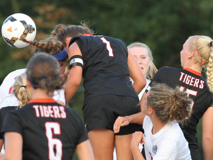 Loveland's Coleen Swift (1) scores a goal during the
