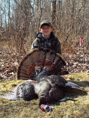 Kaeden Grusnick, 10, of Schofield shot his first turkey in Lincoln County during the Mentored Youth hunt on Sunday, April 12. The bird weighed 22 pounds and had an 11.5 inch beard.
