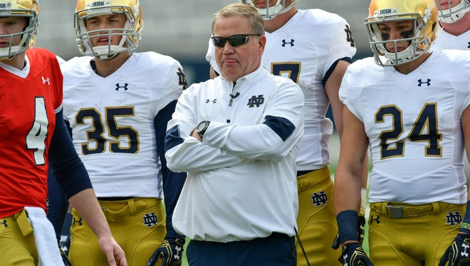 Apr 22, 2017; Notre Dame, IN, USA; Notre Dame Fighting Irish head coach Brian Kelly watches warmups before the Blue-Gold Game at Notre Dame Stadium. Mandatory Credit: Matt Cashore-USA TODAY Sports