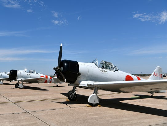 """AT-6 Texans modified to resemble WWII-era Japanese Zeros, wait on the apron at Dyess Air Force Base on Friday. The Commemorative Air Force planes were used in the 1968 movie about the attack on Pearl Harbor, """"Tora, Tora, Tora,"""" and will recreate that event during the weekend's Dyess Big Country Air and Space Expo air show."""