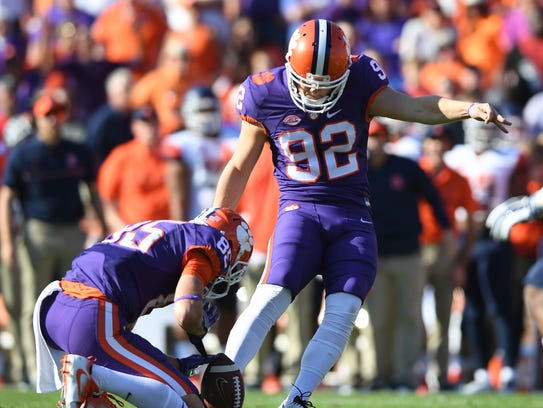 Clemson place kicker Greg Huegel (92) kicks a field