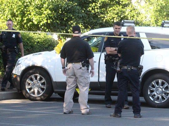 Orangetown Police investigate the scene where a body was found in a car on Erie St. in Blauvelt June 21, 2014.