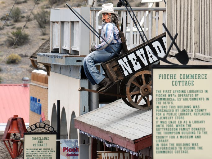 An old cowboy/miner sits in a small wagon atop the Nevada Cub in Pioche.