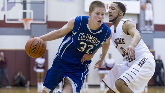 Columbus North High School junior Josh Speidel (32) drives around Lawrence Central High School junior Glen Calvin (30) during second half action of boys varsity basketball at Lawrence Central High School Friday, Jan. 10, 2014. Columbus North defeated Lawrence Central 83-75.
