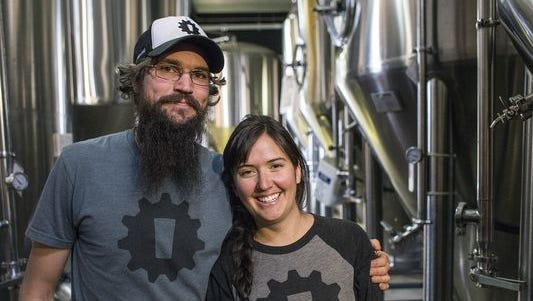 Chip Owen, left, and Nicole Dexter, co-founders and owners of Innovation Brewing in Sylva, are locked in a brewery naming dispute with Bell's Brewery of Kalamazoo.