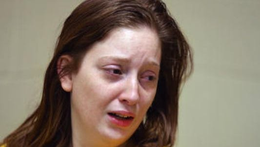 Whitney Blackwell, 27, of Indianapolis talks to the news media in the Marion County Jail in March about the apparently drug-related abduction of her siblings Aaron Blackwell and Emma Blackwell.