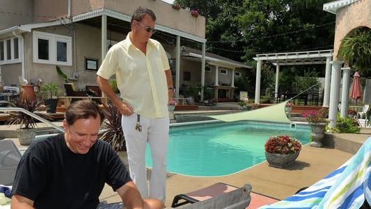 Ted Komacek, left, rents a room at Disgraceland Mansion in East Nashville from Patton James using the Airbnb service. The website pairs travelers with homeowners willing to rent out a portion of their house.