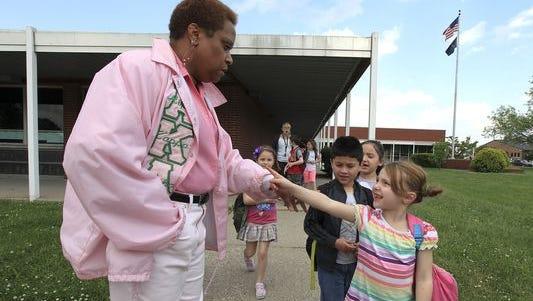 Spring Hill Elementary School principal Virenda Cunningham-Lester says goodbye to kindergartner Madison Fanning as students dismiss. May 18, 2015