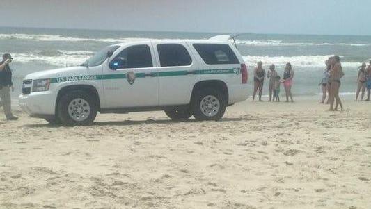 Emergency crews on the scene of a shark attack along Ocracoke Island.
