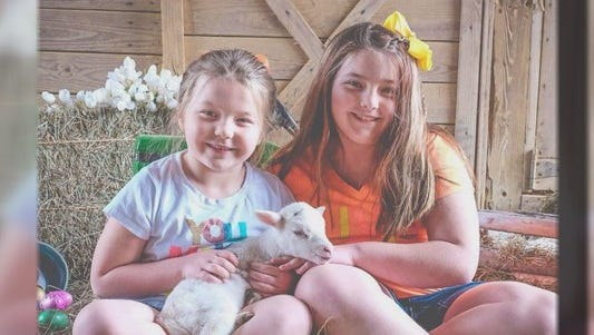 Kimmee Reynolds shared photos and updates on her two daughters, who fell nearly four stories from the top of a Ferris wheel in Greene County Monday.