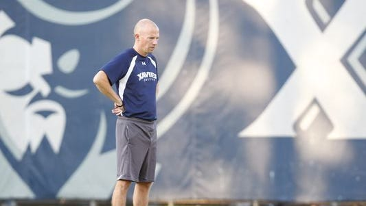 Xavier men's soccer coach Andy Fleming (pictured) and women's coach Woody Sherwood have had to adapt to different practice sites and home game destinations after an August storm damaged the field at Xavier Soccer Complex. The surface is slated to be replaced with new FieldTurf.