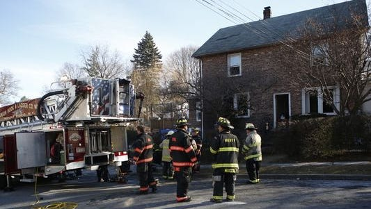 Firefighters on the scene of a fatal fire at 121 St. Marks Place in Mount Kisco on Jan. 20, 2016.