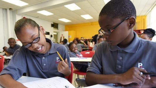 Two students at ReImagine Prep, a Jackson charter school, go over their lessons. RePublic Schools, which serves as the operator for ReImagine Prep, is expanding its footprint in Jackson with plans to open a new charter for the 2019 school year.