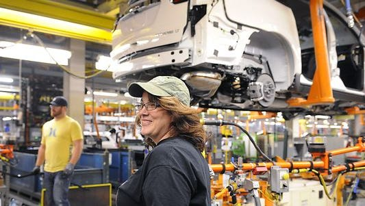 JoAnne Prince waits for the next vehicle to move down the line as she helps build new vehicles at the GM Lansing Delta Township Assembly plant. The plant makes the most American vehicles.