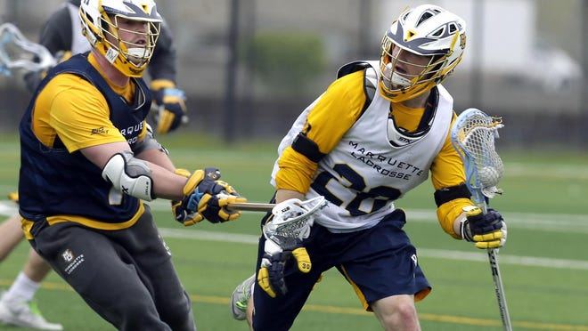 Andy DeMichiei (right, shown at an earlier practice) had a pair of goals for Marquette on Sunday.