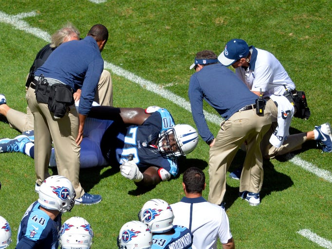 Tennessee Titans guard Chance Warmack lays on the ground