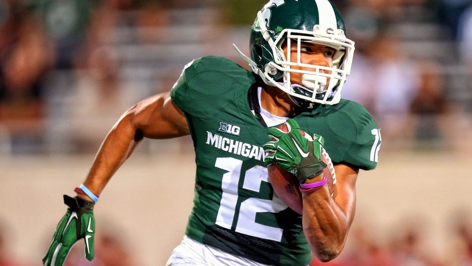 Michigan State wide receiver R.J. Shelton runs after
