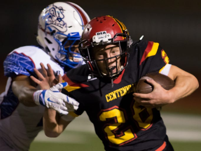 Centennial Hawk Nathan Perez tries to power in more