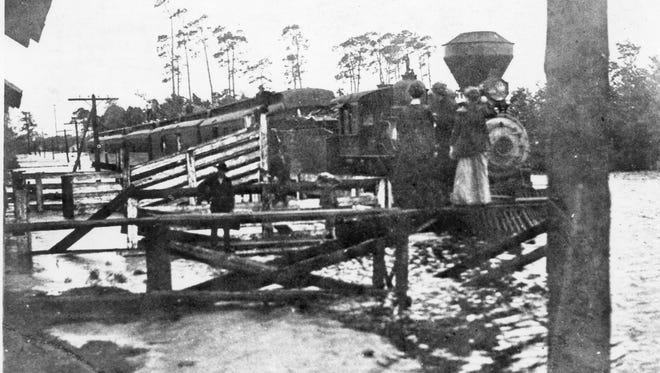 A photo of an L&N train in Milton in high water, circa 1906.