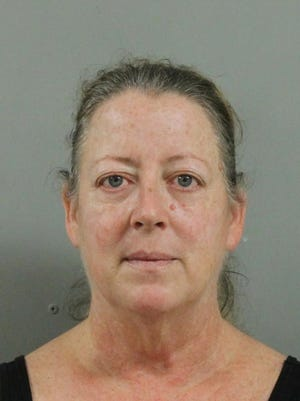 Janette Lauzon was charged with embezzlement from a nonprofit in Ingham County.