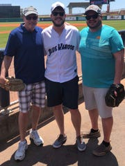 Phil Bowes, center, had his bachelor party on the field at Blue Wahoos Stadium, With him are his father, Tom Bowes, left, and brother Andrew Bowes.