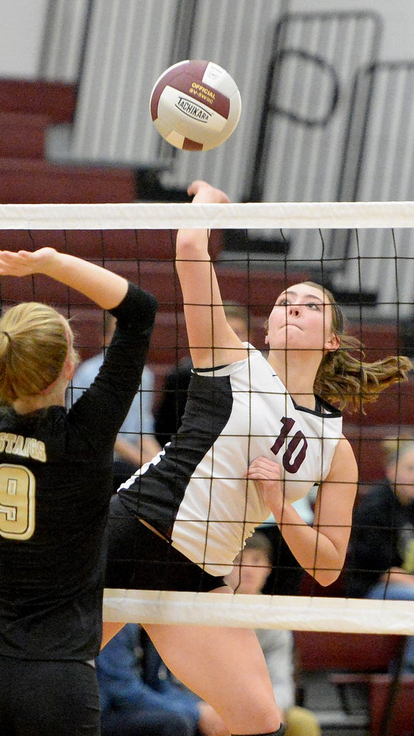 Stuarts Draft's Maddy Riley spikes the ball as Monticello's Michaela Tolley goes for the block during their Conference 29 first-round match Mnday in Stuarts Draft.