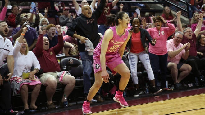 FSU's Leticia Romero celebrates her game-tying 3-pointer to head to overtime as fans cheer in the background during FSU's game against Texas at the Tucker Civic Center.