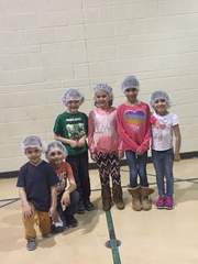 Child volunteers brought their A-game as they filled food bags or Mannapacks.