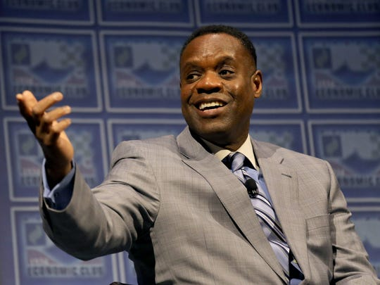 Kevyn Orr acknowledges members of his Emergency Management tean during a Detroit Economic Club Luncheon at Cobo Center in Detroit on Tuesday, January 27, 2015