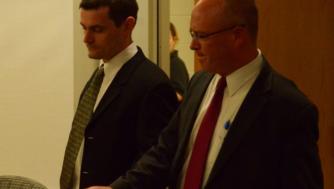 Stephen Getter, left, enters Calhoun County Circuit Court Friday with attorney Brandon Hultink to hear his verdict.