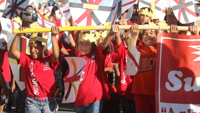 This file photo shows Sunny Sands Elementary School students during the 2013 Cathedral City High School Homecoming parade. This year's parade is on Thursday and will shut down East Palm Canyon Drive.