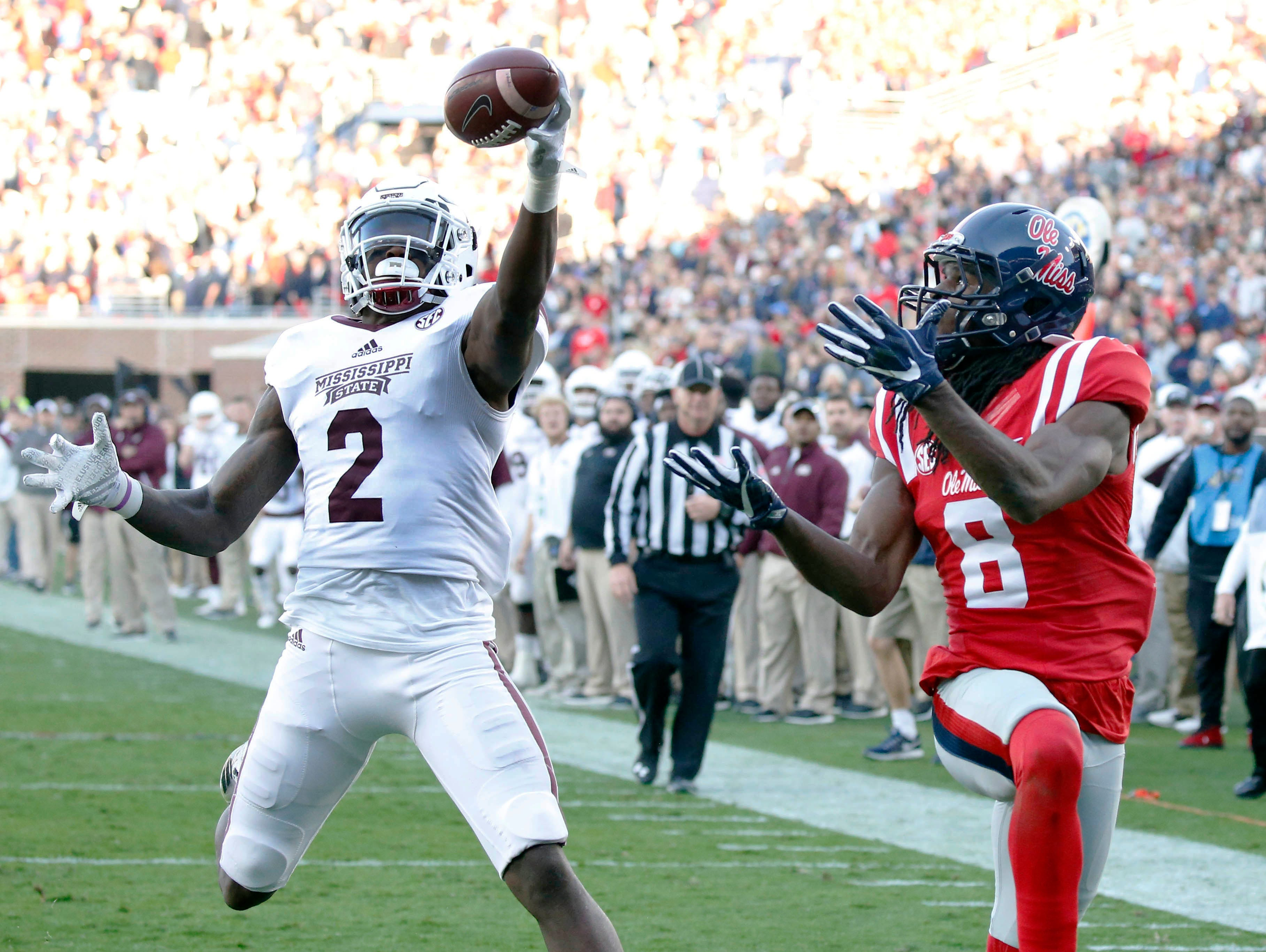 Mississippi State defensive back Jamal Peters (2) reaches up and intercepts a pass intended for Mississippi wide receiver Quincy Adeboyejo (8) in the end zone in the first half of the Egg Bowl Saturday in Oxford.