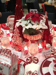 Hosts prepare festively decorated tables for a sit-down