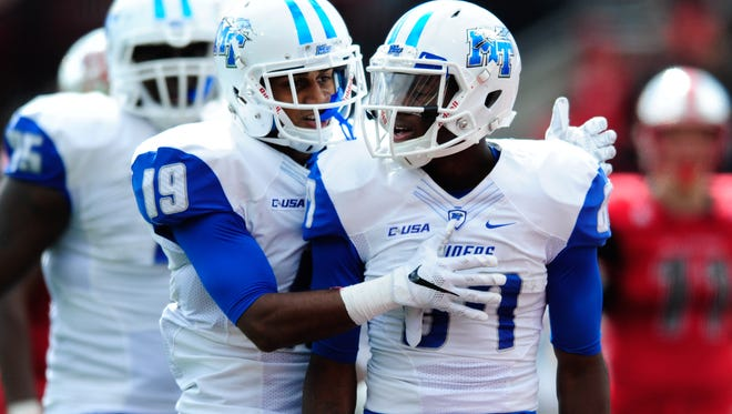 Middle Tennessee Blue Raiders wide receiver Richie James (87) celebrates with wide receiver Derek Barnes (19) after scoring a touchdown during a game earlier this year. MTSU upset Marshall over the weekend.