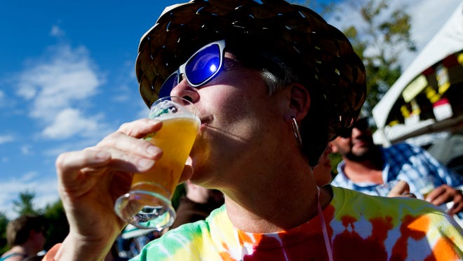 Stephanie Woodings of Maryville, takes a sip of her beer sample at the 21st annual Brewers Jam at World's Fair Park in Knoxville, Tennessee, on Saturday, October 7, 2017. The event draws nearly 2,000 visitors from around the country and this year hosted 49 breweries.