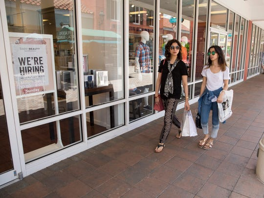 Lubna Alam and her daughter Noreen walk around Miromar Outlets in search of coffee on Thursday, June 29, 2017. Miromar Outlets will not be having fireworks this year due to construction in the area where the fireworks typically launch.