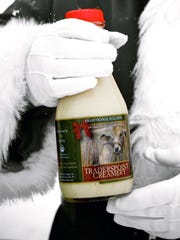 Santa holds the Traditional Eggnog from Traders Point Creamery, 9101 Moore Rd., Zionsville.