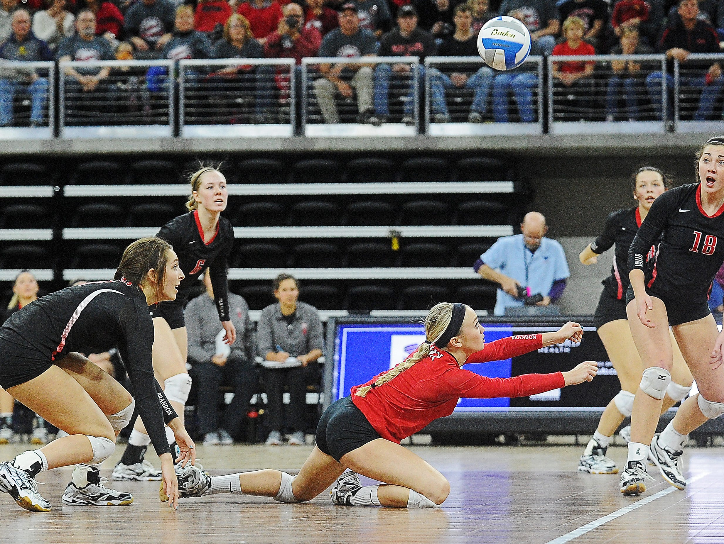 Brandon Valley's Taylor Thorson (1) dives for the ball during the South Dakota State High School Class AA championship volleyball match against Aberdeen Central Saturday, Nov. 21, 2015, at the Denny Sanford Premier Center in Sioux Falls.