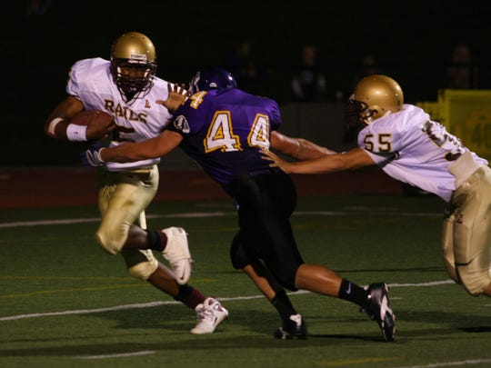Indianola senior linebacker Zac Easter tackles Des Moines Lincoln senior running back TJ James Sept. 18, 2009, in Indianola. Easter, who was diagnosed with chronic traumatic encephalopathy, or CTE, died at age 24.