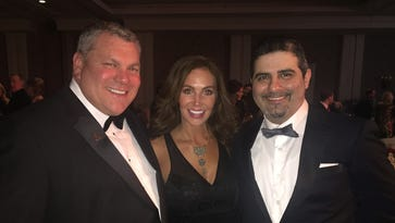 Liberty Bowl president R. Scott Barber, from left, Colleen Palmertree and Romeo Khazen at the Liberty Bowl President's Gala Dec. 29 at The Peabody.