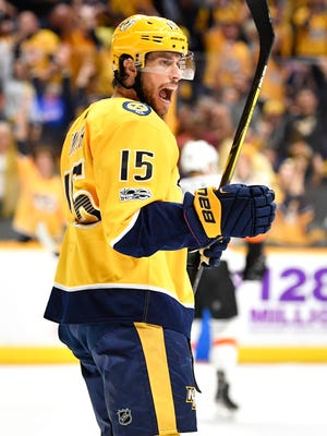 Nashville Predators right wing Craig Smith (15) celebrates his goal early in the first period of the home opener at Bridgestone Arena in Nashville, Tenn., Tuesday, Oct. 10, 2017.