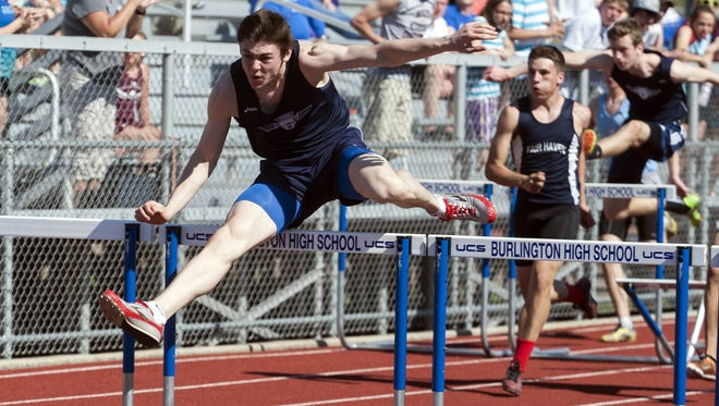 Mount Mansfield's Alec Eschholz competes in the 110-meter hurdles race during the Burlington track and field invitational Saturday.
