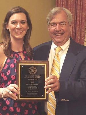 Kara Wheeler, South Carolina Independent Schools Association middle school teacher of the year,  and Dr. Larry Watt, SCISA Executive Director