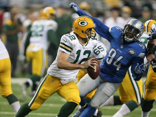 Detroit Lions Ezekiel Ansah pursues the Green Bay Packers Aaron Rogers during first half action on Thursday, December 3, at Ford Field in Detroit Michigan.