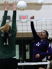 Mescalero's Katelyn Yuzos spikes a ball toward Cloudcroft's Diana Cook.