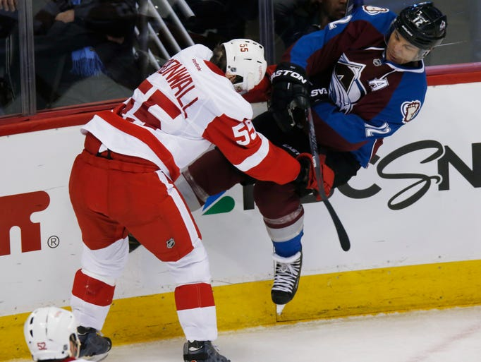 Red Wings defenseman Niklas Kronwall, left, hits Avalanche