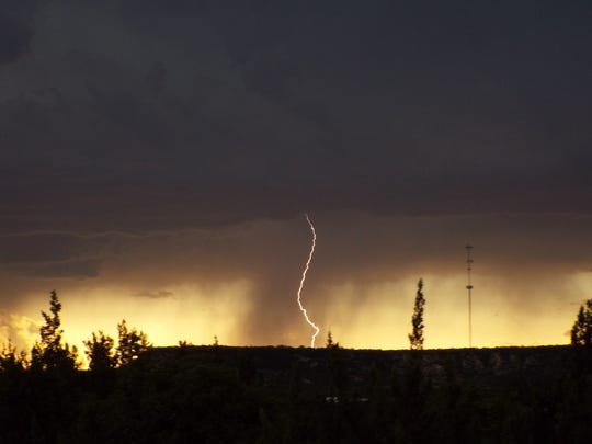 Lightning strikes before the rain Saturday, June 23,