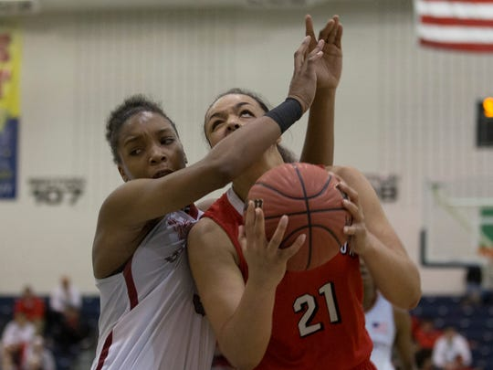 Bound Brook's Janee'a Summers gets fouled by University's Amayah Powell durin first half action. Bound Brook vs University in Public Group 1 Girls Basketball Final in Toms River NJ, on March 12, 2017.