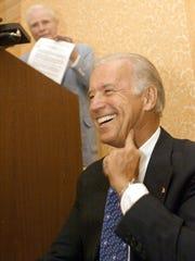 Sen. Joe Biden, D-Del., foreground, laughs as former